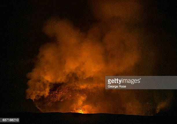 The Kilauea Volcano caldera continues to bubble with lava belching gasses such as carbon dioxide and sulphur dioxide into the air as viewed on...
