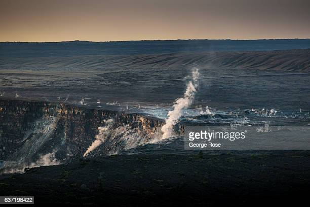 The Kilauea Volcano caldera continues to bubble with lava belching steam and gasses such as carbon dioxide and sulphur dioxide into the air as viewed...