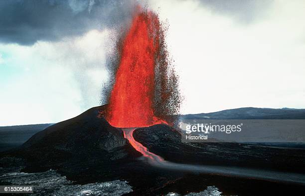The Kilauea Volcano erupts with great force shooting a lava fountain high into the air