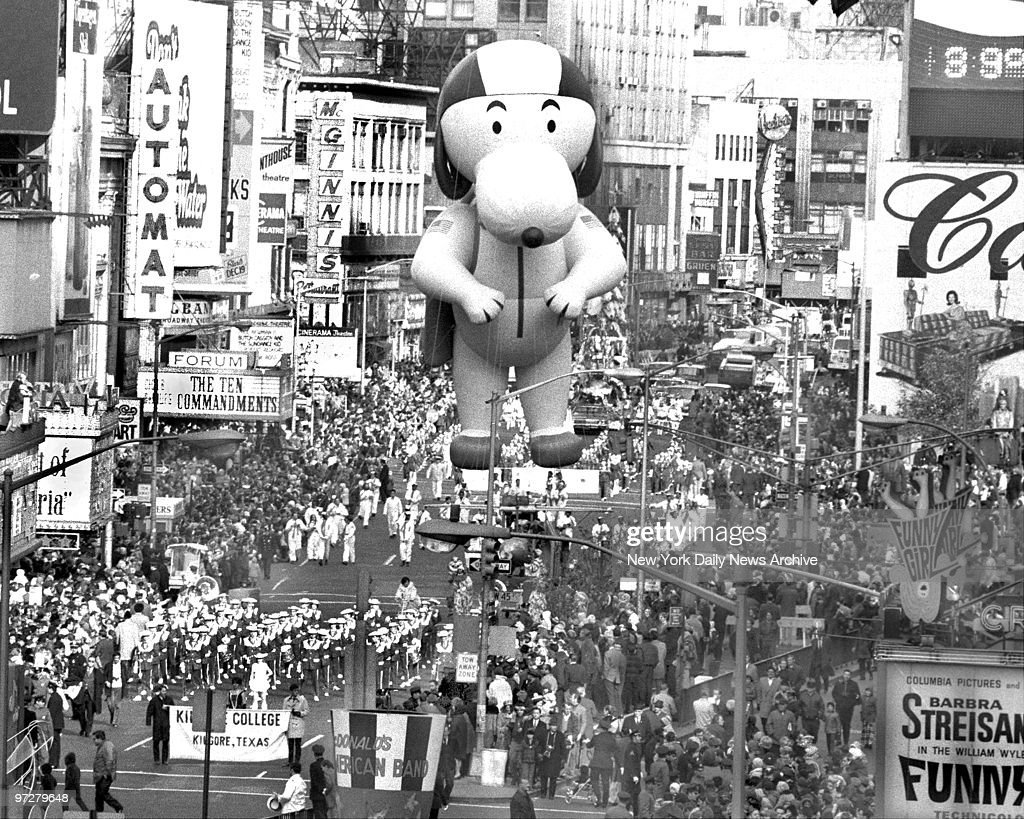 The Kilgore, Texas band struts its stuff and so does Snoopy as the 43d annual Macy's Thanksgiving Day Parade moves through Times Square.