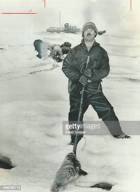 The kill Roger Le Tomplier one of 200 sealers hunting off Labrador poses with the carcass of a 1weekold pup Christie Blatchford writes from the...