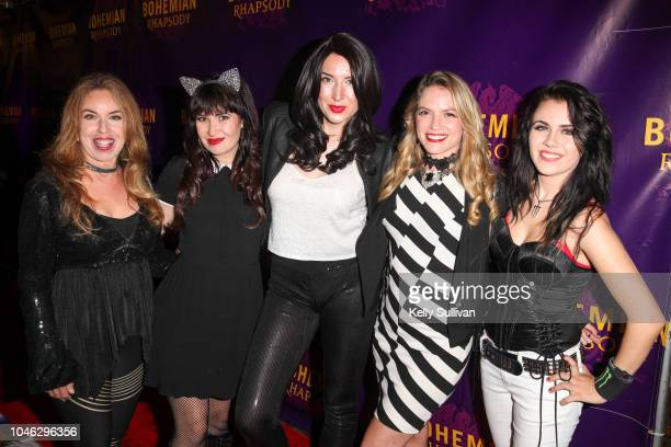 The Killer Queens the world's only allfemale Queen tribute band pose for a photo on the red carpet for a special screening of 'Bohemian Rhapsody' at...
