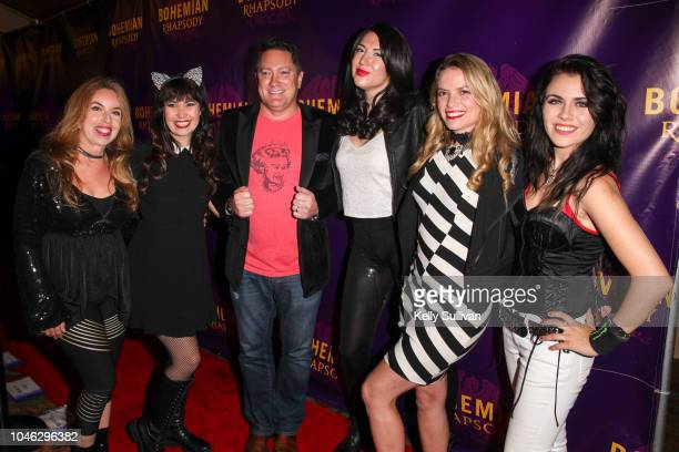 The Killer Queens the world's only allfemale Queen tribute band pose for a photo with TV personality Liam Mayclem on the red carpet for a special...