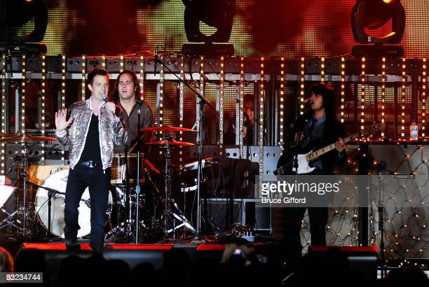 The Killers bassist Mark Stoermer, singer Brandon Flowers and drummer Ronnie Vannucci perform at the 13th annual Andre Agassi Charitable Foundation's...
