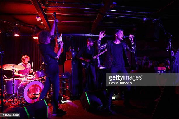 The Killers drummer Ronnie Vannucci Jr guitarist Dave Keuning singer Brandon Flowers and bass guitarist Mark Stoermer perform at Bunkhouse on April 7...