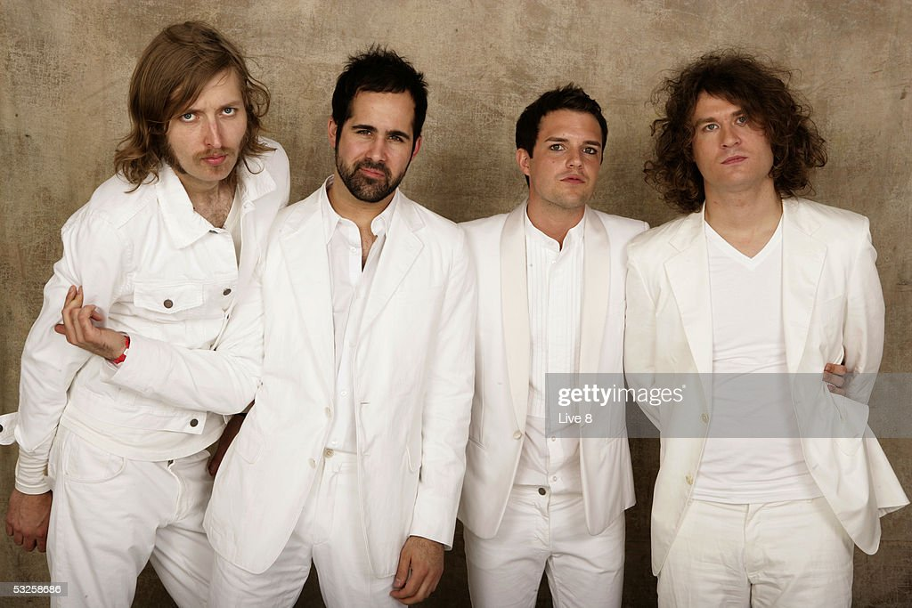 The Killers pose for a studio portrait backstage at 'Live 8 London' in Hyde Park on July 2, 2005 in London, England. The free concert is one of ten simultaneous international gigs including Philadelphia, Berlin, Rome, Paris, Barrie, Tokyo, Cornwall, Moscow and Johannesburg. The concerts precede the G8 summit (July 6-8) to raising awareness for MAKEpovertyHISTORY.