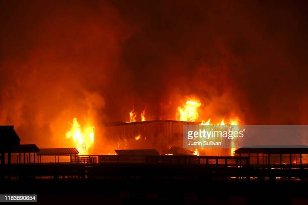 The Kincade Fire burns a structure on October 27 2019 in Santa Rosa California Fueled by high winds the Kincade Fire has burned over 30000 acres and...