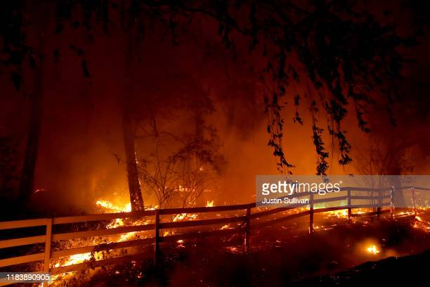 The Kincade Fire burns along Fraught Road on October 27 2019 in Santa Rosa California Fueled by high winds the Kincade Fire has burned over 30000...