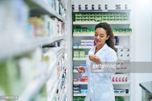 the kind of medicinal knowledge you want from your pharmacist - antibiotic stock pictures, royalty-free photos & images