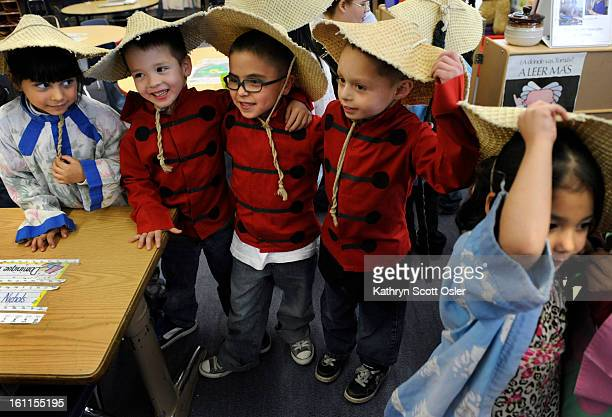 The kindergarten classes at Force Elementary in Denver celebrate the Chinese New Year by dressing up in costumes and parading from classroom to...