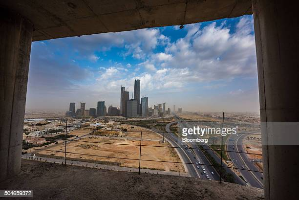 The King Abdullah financial district sits on the horizon seen through the window of a skyscraper under construction in Riyadh Saudi Arabia on Sunday...