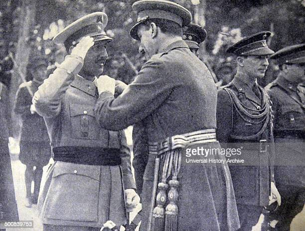 The King Alphonso XIII gives a Military Medal to General Franco