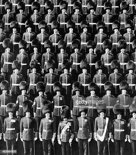 The King and his guards, 1935. King George V and the King's Company of the 1st Battalion, Grenadier Guards, on the terrace at Windsor Castle. A print...