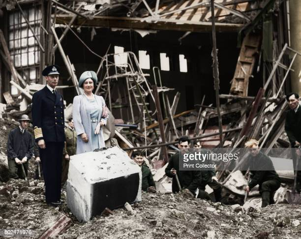 The King and Queen survey bomb damage Buckingham Palace London WWII 1940 King George VI and Queen Elizabeth looking at the aftermath of a German...