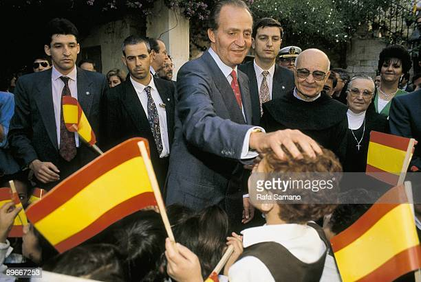 The King and the Queen of Spain visit Israel `Juan Carlos I King of Spain greets the children of a school behind Javier Solana talking in a group of...