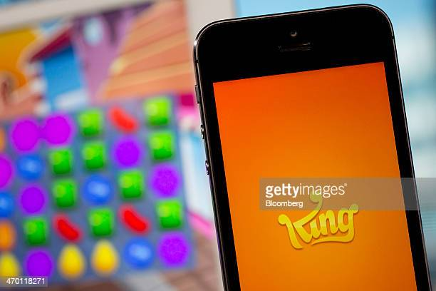 The King Digital Entertainment Plc logo and Candy Crush Saga game are displayed on an Apple Inc iPhone 5s and iPad Air in this arranged photograph in...