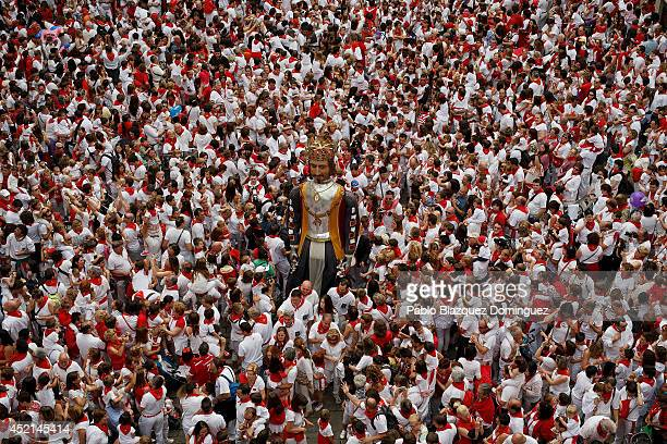 The King Giant figure dance surrounded by children and revellers during the farewell ceremony of the Comparsa de Gigantes y Cabezudos 'Giants and Big...
