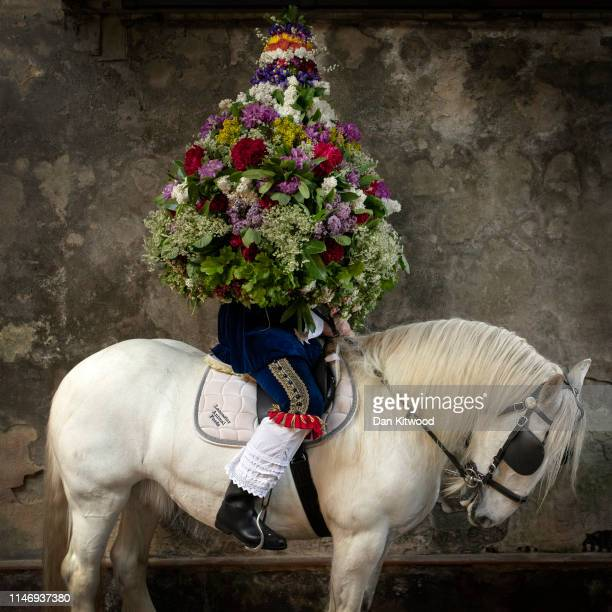 'The King' Johnathon Haddock poses for a portrait with the Garland before the procession during 'Castleton Garland Day' on May 29 2019 in Castleton...