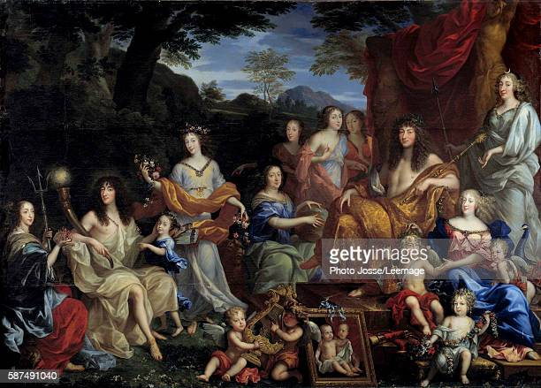 The king Louis XIV and his family dressed up in mythological figures The King on the right seated on a throne as Apollo At the bottom right the Queen...