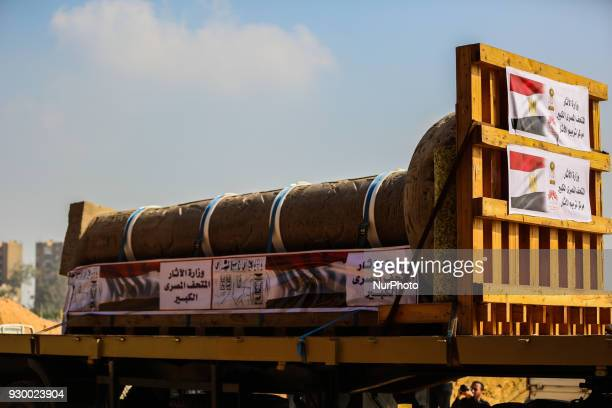 The King Merneptah pillar is loaded onto a truck to be transferred to its permanent display area at the Atrium of the Grand Egyptian Museum near the...