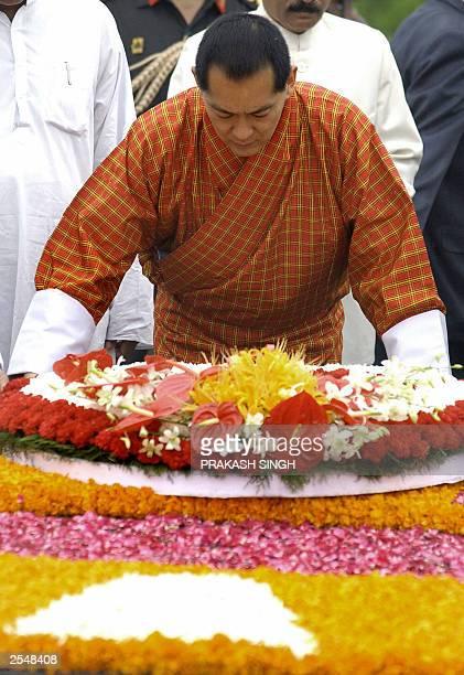 The King of Bhutan Jigme Singye Wangchuck lays a wreath at Raj Ghat, the memorial to Mahatma Gandhi, in New Delhi, 15 September 2003. Wangchuck is on...