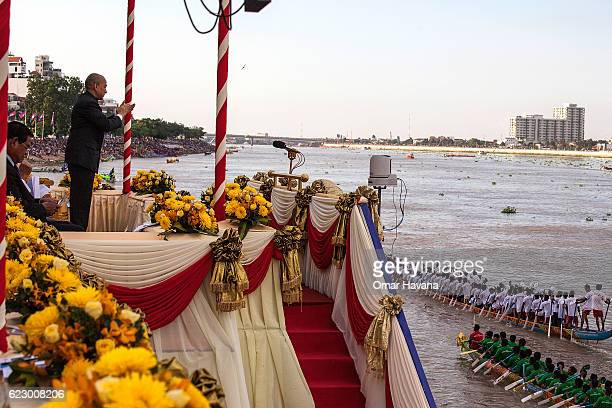 The King of Cambodia Norodom Sihamoni greets boat racers during the first day of the Water Festival on November 13 2016 in Phnom Penh Cambodia The...