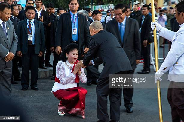 The King of Cambodia Norodom Sihamoni greets Cambodian First Lady Bun Rany in front of the Royal Palace during the first day of the Water Festival on...