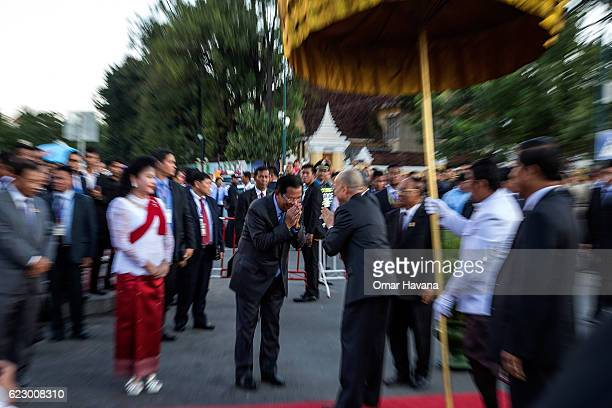 The King of Cambodia Norodom Sihamoni greets Cambodian Prime Minister Samdech Hun Sen in front of the Royal Palace during the first day of the Water...