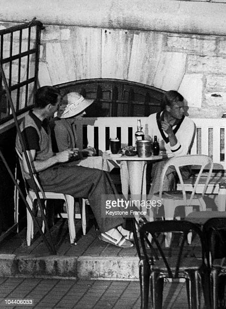 The King of England EDWARD VIII and his fiance Ms Wallis SIMPSON at a restaurant with a friend while vacationing in Biarritz France in 1936