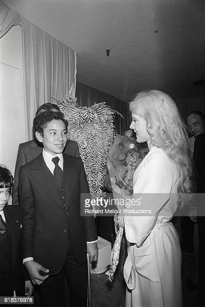 The king of Morocco's children visit with singer Sylvie Vartan after a performance in Paris The children who came from Rabat to see the show offered...