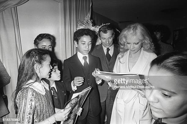 The king of Morocco's children visit with singer Sylvie Vartan after a performance in Paris. The children, who came from Rabat to see the show,...