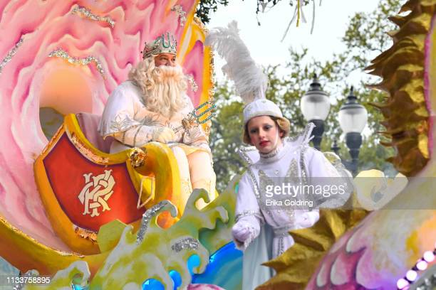 The King of Proteus, whose identity is never revealed to the public, leads his krewe's parade along the traditional Uptown parade route with the...