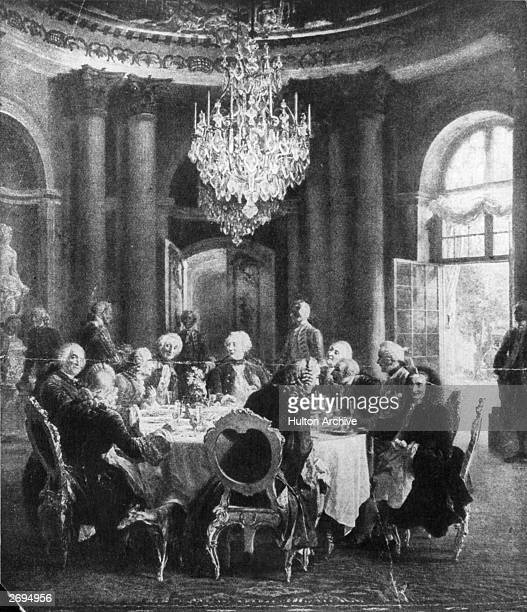 The King of Prussia Friedrich the Great at the table in the Sans Souci Palace where distinguished notables including Voltaire were entertained...
