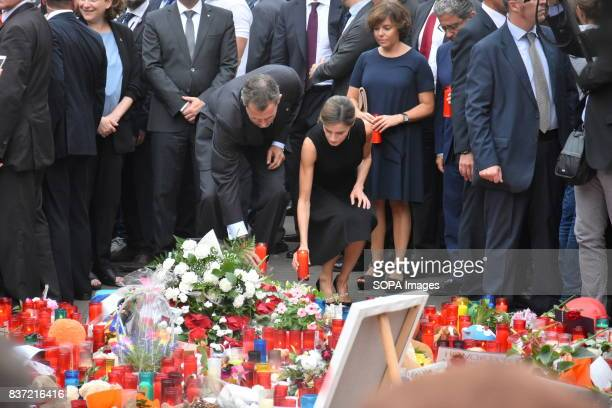 The King of Spain Don Felipe VI and Queen Dona Leticia attend a vigil and lay flowers and candles for the victims of the attacks in Barcelona