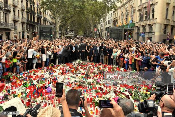 The King of Spain Don Felipe VI and Queen Dona Leticia attend a vigil and lay flowers for the victims of the attacks in Barcelona with hundreds of...