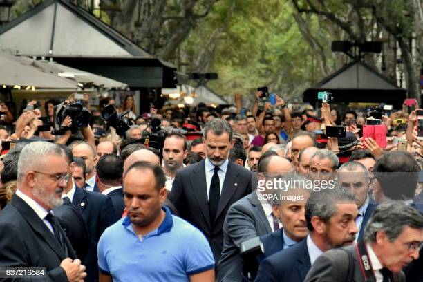 The King of Spain Don Felipe VI seen walking towards the location of the Barcelona terror attack to lay flower and pay tribute to the victims