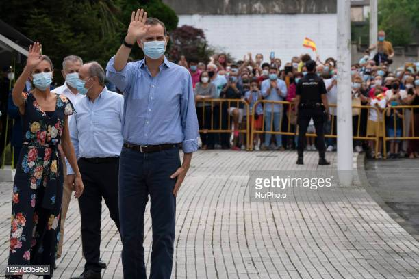 The King of Spain Felipe VI and his wife Dona Letizia greet upon arrival at the Cantabrian town of Torrelavega, during their visit to the community...