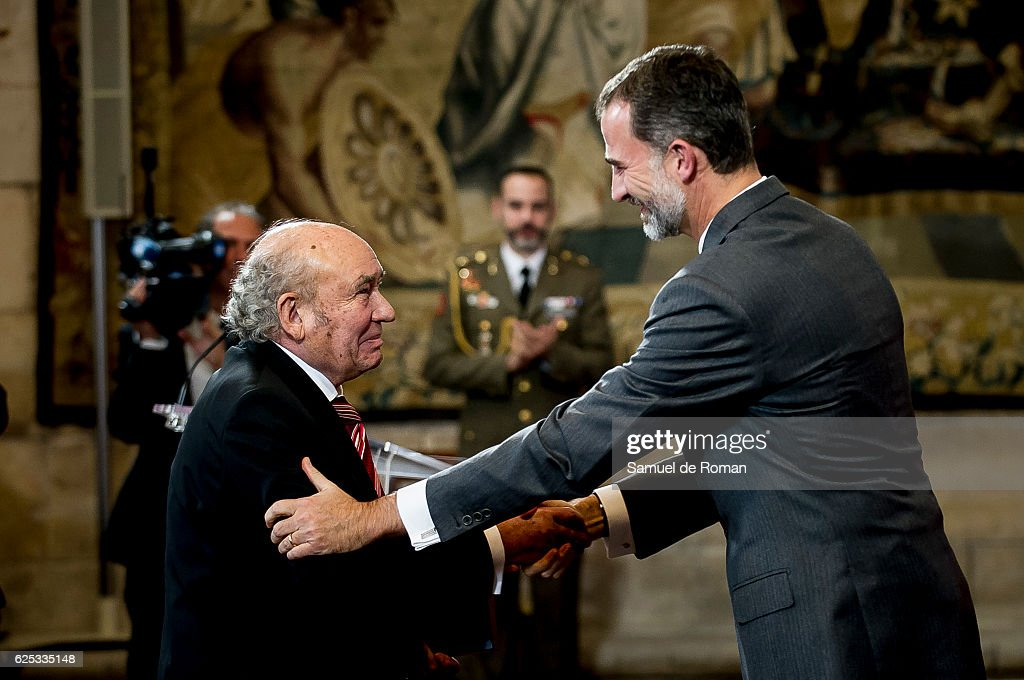 The King of Spain Felipe VI hands over the businesmen of the year prize to Jose Antolin on November 23, 2016 in Burgos, Spain.