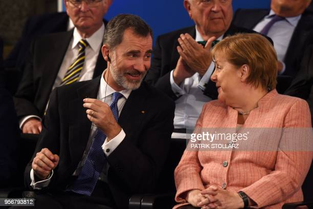 The King of Spain Felipe VI talks with German Chancellor Angela Merkel before the Charlemagne prize award ceremony on May 10 2018 in Aachen western...
