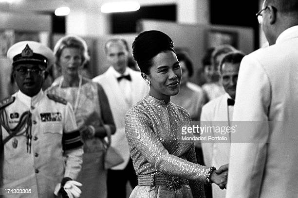 The King of Thailand Bhumibol Adulyadej and her wife Sirikit taking part at a concert with works of Johann Sebastian Bach Bangkok 1965