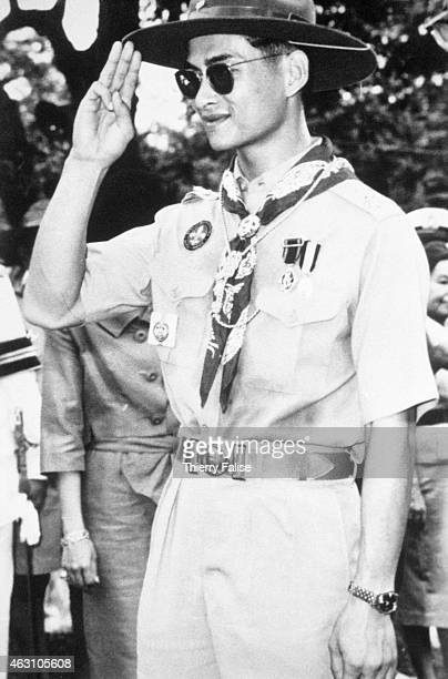 The king of Thailand Bhumibol Adulyadej salutes as a boy scout The king is the chief of the National Scout Organization of Thailand Picture taken...