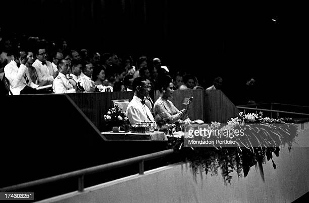 The King of Thailand Bhumibol Adulyadej taking part in a concert with works of Johann Sebastian Bach with his wife the Queen Sirikit Bangkok 1965