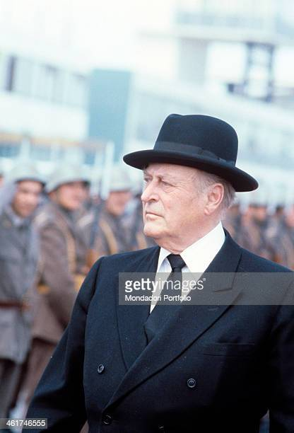 The king Olav V of Norway inspecting a marshalled Yugoslavian army detachement Olav V just landed at the airport of Belgrade to attend the funerals...