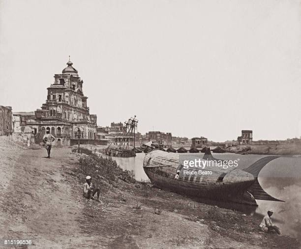 The King's boat The Royal Boat of Oude moored on the River Gomti near the Chutter Munzil or Chattar Manzil in Lucknow Uttar Pradesh India 1858...