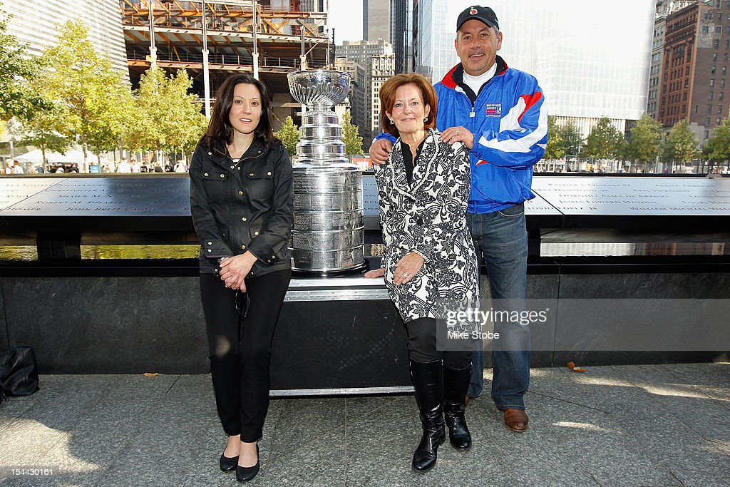 The Kings brought the Stanley Cup to Ground Zero in New York in conjunction with the National Hockey League, the Hockey Hall of Fame and the New York Police Department to pay tribute to former club scouts Garnet 'Ace' Bailey and Mark Bavis. Colleen Bavis, Kathy Bavis Sylvester and Paul Sylvester pose for a picture with the Stanley Cup next to the spot where their family member's names are etched on the reflecting pool wall at the 9/11 Memorial site.