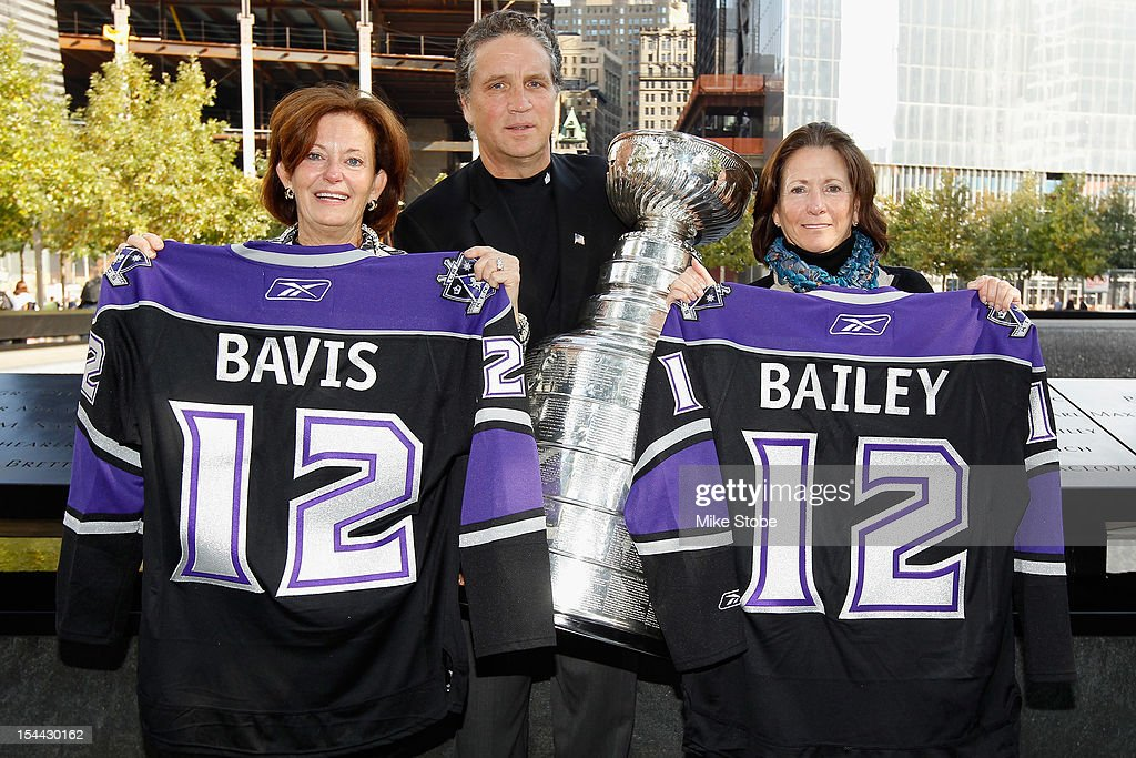 The Kings brought the Stanley Cup to Ground Zero in New York in conjunction with the National Hockey League, the Hockey Hall of Fame and the New York Police Department to pay tribute to former club scouts Garnet 'Ace' Bailey and Mark Bavis. Kathy Bavis Sylvester, Dean Lombardi and Katherine Bailey pose for a picture with LA Kings jerseys and the Stanley Cup next to the spot where their family member's names are etched on the reflecting pool wall at the 9/11 Memorial site.