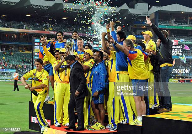 The Kings celebrate victory with the trophy during the 2010 Airtel Champions League Twenty20 final match between Chennai Super Kings and Chevrolet...