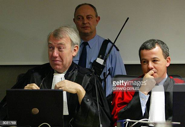 The king's prosecutor Michel Bourlet and AttorneyGeneral JeanBaptiste Andries are pictured 02 March 2004 in the courthouse of the southeastern...