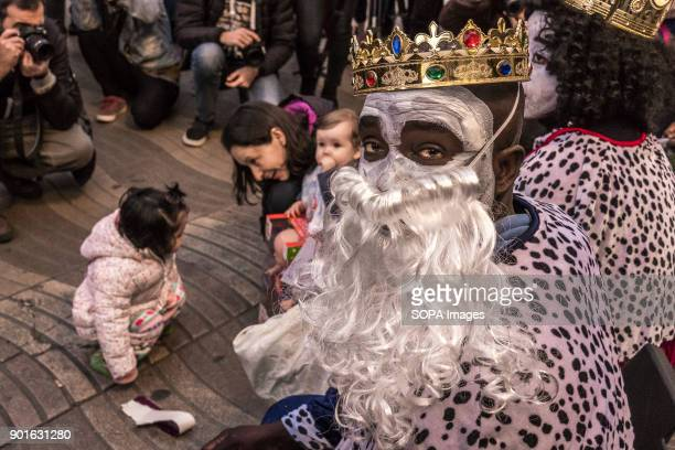 The Kings street vendors seen distributing candies to children The Three Wise Men handing out candies is a Spanish tradition since the 19th century...