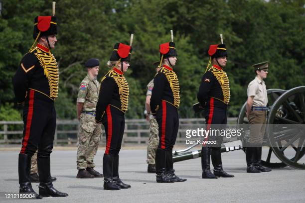The King's Troop Royal Horse Artillery carry out a socially distanced parade of 20 soldiers with their first world war Guns to commemorate the 75th...